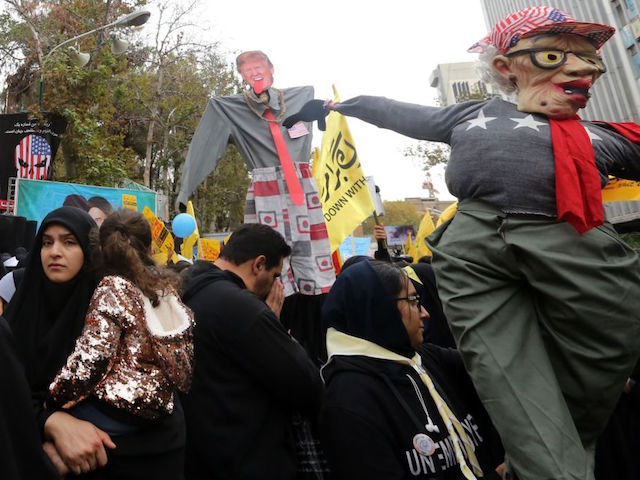 Iranian protesters hold anti-US effigies and banners during a rally outside the former US embassy in the capital Tehran on November 4, 2019, to mark the 40th anniversary of the Iran hostage crisis. - On November 4, 1979, less than nine months after the toppling of Iran's American-backed shah, students overran the embassy complex to demand the United States hand over the ousted ruler after he was admitted to a US hospital. (Photo by ATTA KENARE / AFP) (Photo by ATTA KENARE/AFP via Getty Images)