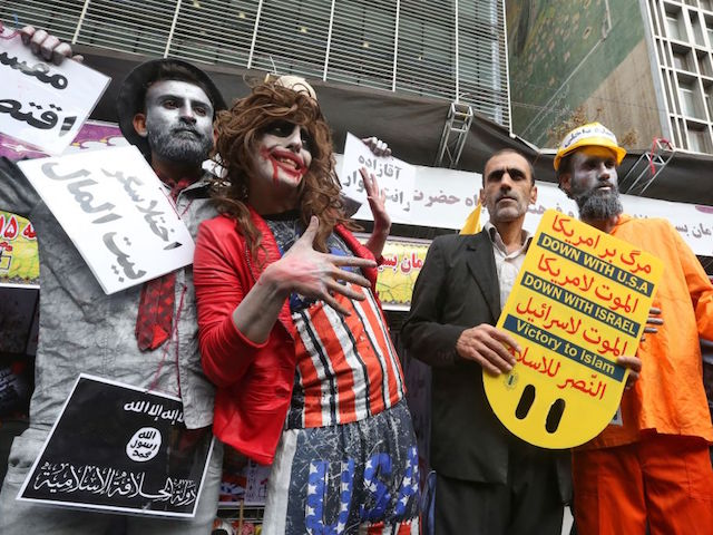 Iranian protesters hold placards with anti-US slogans during a rally outside the former US embassy in the capital Tehran on November 4, 2019, to mark the 40th anniversary of the Iran hostage crisis. - On November 4, 1979, less than nine months after the toppling of Iran's American-backed shah, students overran the embassy complex to demand the United States hand over the ousted ruler after he was admitted to a US hospital. (Photo by ATTA KENARE / AFP) (Photo by ATTA KENARE/AFP via Getty Images)