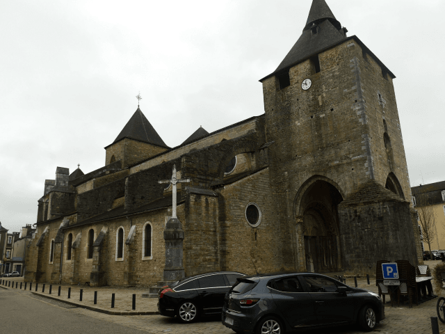 This picture taken on November 4, 2019, shows the facade of the Sainte-Marie cathedral in Oloron-Sainte-Marie, near Pau, southwestern France, after a robbery. - Robbers rammed their car into the mediaeval cathedral, registered as a UNESCO World Heritage site, early on November 4, sawing through metal bars to grab silver …