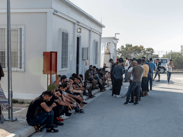 Syrian refugees rest inside the Temporary Accommodation Centre in Kokkinotrimithia, some 20 kilometres outside the Cypriot capital Nicosia on November 5, 2019. - Cyprus police said they towed to shore 131 migrants, almost all from Syria, after they were sighted on an overcrowded boat off the Mediterranean islands northwest tip. …