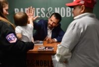 "Donald Trump Jr., greets a child as he signs his new Book ""Triggered: How the Left Thrives on Hate and Wants to Silence Us"" at Barnes & Noble on 5th Avenue on November 5, 2019 in New York. (Photo by Angela Weiss / AFP) (Photo by ANGELA WEISS/AFP via Getty …"