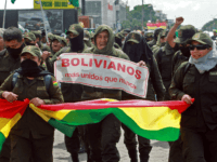 "Police officers, who have joined a rebellion, take part in a march to protest against Bolivian President Evo Morales with a sign reading ""Bolivians more united than ever"" in Santa Cruz, Bolivia, on November 9, 2019. - Police in three Bolivian cities joined anti-government protests Friday, in one case marching …"
