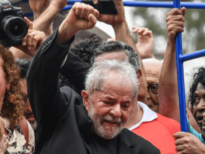 Brazilian former president (2003-2011) Luiz Inacio Lula da Silva raises his fist during a rally outside the metalworkers' union building in Sao Bernardo do Campo, in metropolitan Sao Paulo, Brazil, on November 9, 2019. - Brazil's leftist icon Luiz Inacio Lula da Silva walked free from jail Friday after a …