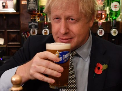 WOLVERHAMPTON, UNITED KINGDOM - NOVEMBER 11: British Prime Minister Boris Johnson sips a pint of beer as he campaigns ahead of the general election at the Lynch Gate Tavern on November 11, 2019 in Wolverhampton, United Kingdom. The U.K. will go to the polls in a general election on December …