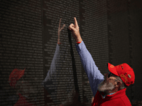 A veteran points to a name on the Vietnam War Memorial on Veterans Day on November 11, 2019 in Washington, DC. (Photo by MANDEL NGAN / AFP) (Photo by MANDEL NGAN/AFP via Getty Images)