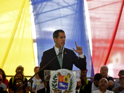 """Venezuelan opposition leader and self-proclaimed acting president Juan Guaido speaks during a meeting with union leaders, in Caracas on November 11, 2019. - Guaido said Monday the resignation of Bolivian President Evo Morales was a """"hurricane of democracy"""" and renewed his call for protests against Venezuelan President Nicolas Maduro. (Photo …"""