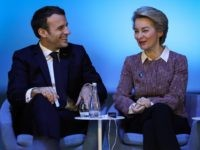 European Commission president Ursula von der Leyen (R) speaks to French President Emmanuel Macron at the start of the Paris Peace Forum, on November 12, 2019 in Paris. (Photo by LUDOVIC MARIN / POOL / AFP) (Photo by LUDOVIC MARIN/POOL/AFP via Getty Images)