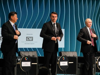 Brazil's President Jair Bolsonaro (C), Russia's President Vladimir Putin (R) and China's President Xi Jinping (L), attend the BRICS Business Council prior to the 11th edition of the BRICS Summit, in Brasilia, on November 13, 2019. - Bolsonaro walked a diplomatic tightrope, as he seeks to boost ties with Beijing …