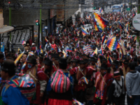 Supporters of Evo Morales wearing the traditional ponchos and holding Wiphala flags take part in a protest on November 14, 2019 in La Paz, Bolivia. Since Evo Morales resignation due to back withdrawal from armed forces, his supporters have been flooding into the streets of El Alto clashing with police. …