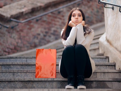 Shopaholic girl feeling exhausting after shopping spree