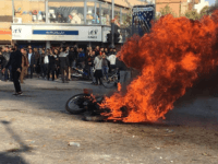 Iranian protesters gather around a burning motorcycle during a demonstration against an increase in gasoline prices in the central city of Isfahan, on November 16, 2019. - One person was killed and others injured in protests across Iran, hours after a surprise decision to increase petrol prices by 50 percent …