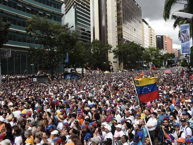 """CARACAS, VENEZUELA - NOVEMBER 16: Supporters of Juan Guaido gatters as he speach in Chacaito, Caracas. Venezuelan opposition leader Juan Guaido, recognized by many members of the international community as the country's rightful interim ruler, speaks during rally so-called """"Wake up Venezuela"""" at Plaza Jose Marti to boost pressure on President Nicolas Maduro to resign on November 16, 2019 in Caracas, Venezuela. Last night an unidentified group of armed people dressing military uniforms broke into the headquarters of Juan Guaido's party Voluntad Popular. Guaido's call for renewed protests came as political turmoil affect countries across the region forcing leaders into concessions and even contributing to Evo Morales resignation under pressure. Guaido is willing to bring new energy as frustration grew after inability to remove Maduro from power. (Photo by Getty Images/Getty Images)"""