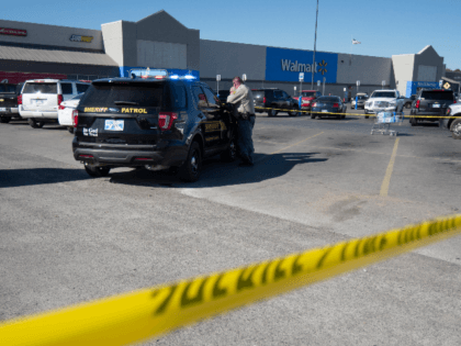 A police officer maintains a security line after a shooting in a Walmart parking lot on November 18, 2019 in Duncan, Oklahoma. A gunman killed two people in a car in the parking lot outside an Oklahoma Walmart before fatally shooting himself. (Photo by J Pat Carter/Getty Images)