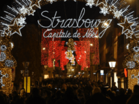 This picture taken on November 22, 2019 shows a view of the city's illuminated sign and Christmas street decorations as people gather on the opening day of the 450th traditional Christmas market in Strasbourg, eastern France, one year after the deadly attack that killed five people. - On December 11, …