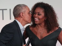 CHICAGO, ILLINOIS - OCTOBER 29: Former U.S. President Barack Obama gives his wife Michelle a kiss as they close the Obama Foundation Summit together on the campus of the Illinois Institute of Technology on October 29, 2019 in Chicago, Illinois. The Summit is an annual event hosted by the Obama …