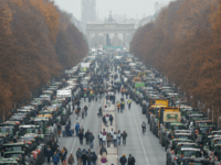 "Overall view shows hundreds of farmers lining up with their tractors along ""Strasse des 17. Juni"" Avenue towards Brandenburg Gate (background) during a protest on November 26, 2019 in Berlin against the German government's agricultural policy including plans to phase out glyphosate pesticides and to implement more animal protection. (Photo …"
