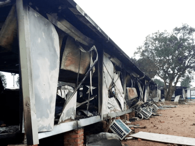 Burnt containers are seen at the United Nations (UN) civil base in Beni in the eastern part of the Democratic Republic of Congo on November 26, 2019. - On November 25, 2019 angry demonstrators ransacked and looted the UN civil base in Beni. At least four demonstrators were killed in …