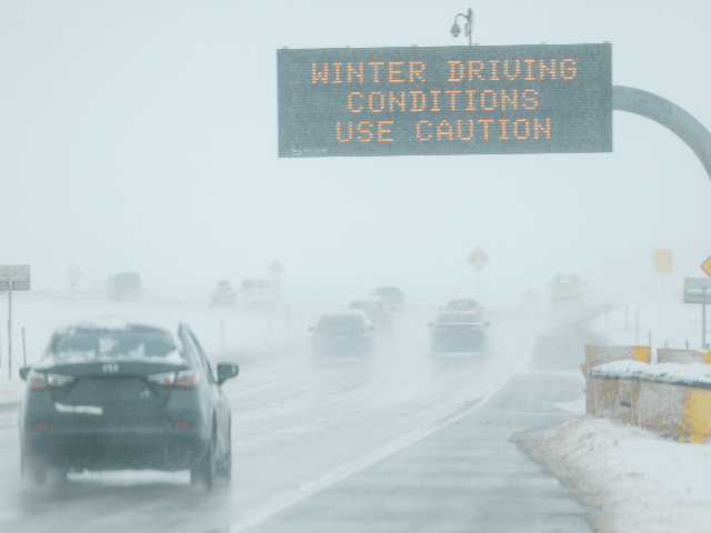 Drivers make their way along slick and snowy roads on November 26, 2019 in Denver, Colorado. A strong winter storm dropped nearly a foot of snow on the city. (Photo by Joe Mahoney/Getty Images)