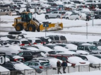 DENVER, CO - NOVEMBER 26: People walk past snow-covered cars parked as a plow clears roadways at Denver International Airport on November 26, 2019 in Denver, Colorado. Flights were delayed and rescheduled due to a winter storm that dropped nearly a foot of snow in the city. (Photo by Joe …