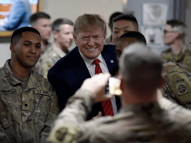 US President Donald Trump serves Thanksgiving dinner to US troops at Bagram Air Field during a surprise visit on November 28, 2019 in Afghanistan. (Photo by Olivier Douliery / AFP) (Photo by OLIVIER DOULIERY/AFP via Getty Images)