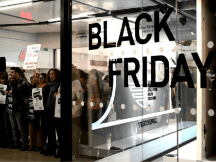 """Youth for climate"" activists demonstrate against the Black Friday in the Quatre Temps mall at La Defense business district, West of Paris, on November 29, 2019. (Photo by Philippe LOPEZ / AFP) (Photo by PHILIPPE LOPEZ/AFP via Getty Images)"
