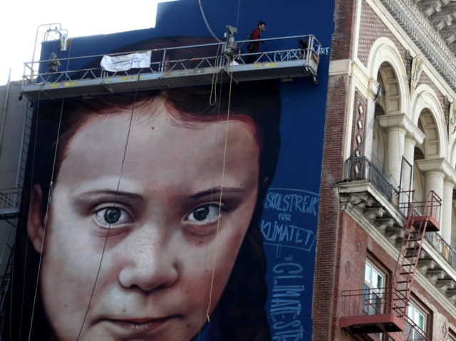 SAN FRANCISCO, CALIFORNIA - NOVEMBER 11: A view of a new four-story-high mural of Swedish climate activist Greta Thunberg on November 11, 2019 in San Francisco, California. A new mural honoring 16 year-old Swedish climate activist Greta Thunberg is nearing completion on the side of a building near San Francisco's …