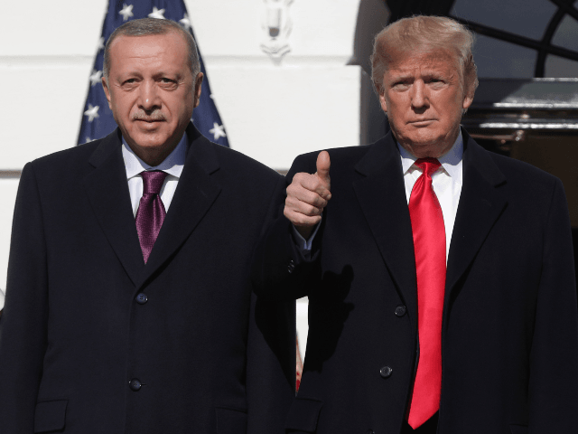 U.S. President Donald Trump (R) gives a thumbs up will greeting Turkish President Recep Tayyip Erdogan upon his arrival at the South Portico of the White House on November 13, 2019 in Washington, DC. The two leaders will meet in the Oval Office before speaking to the media during an …