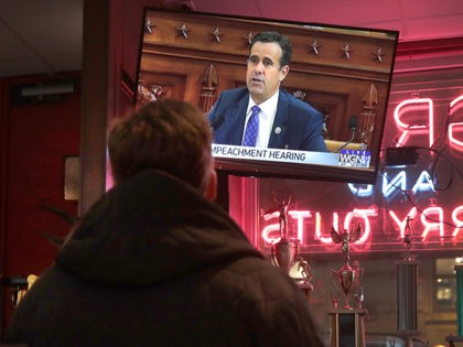 CHICAGO, ILLINOIS - NOVEMBER 13: Live testimony of the House impeachment hearings against President Donald Trump is shown on a television at the Billy Goat Tavern on November 13, 2019 in Chicago, Illinois. In the first public impeachment hearings in more than two decades, House Democrats are making a case …