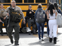Students are evacuated from Saugus High School onto a school bus after a shooting at the school left two students dead and three wounded on November 14, 2019 in Santa Clarita, California. A suspect in the shooting is being treated at a local hospital for a gunshot wound to the …