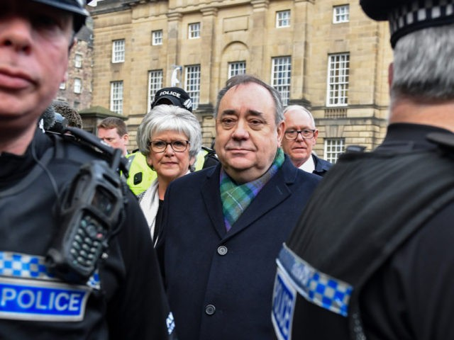 EDINBURGH, SCOTLAND - NOVEMBER 21: Former Scottish first minister Alex Salmond leaves the High Court surrounded by police and the media after a preliminary hearing on sexual assault charges on November 21, 2019 in Edinburgh, United Kingdom. Salmond has been accused of 14 counts of sexual assault and attempted rape …
