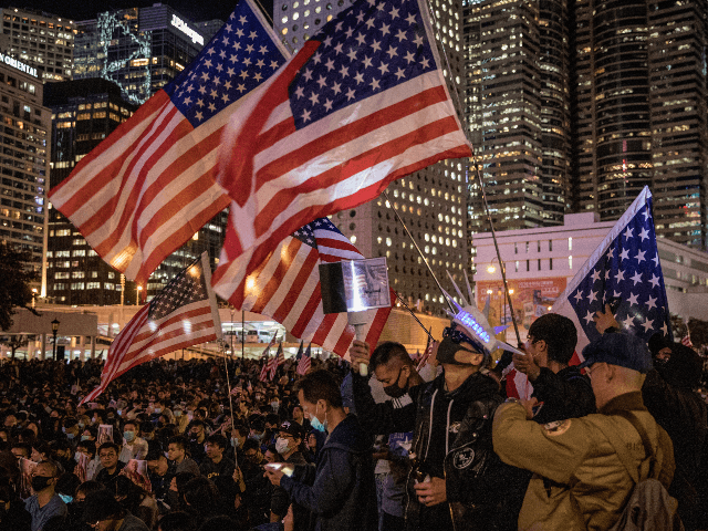 "Pro-democracy protesters take part in a Thanksgiving Day rally at Edinburgh Place on November 28, 2019 in Hong Kong, China. Protesters gathered to say thank you to the United States after US President Donald Trump signed legislation supporting the Hong Kong pro-democracy protesters, with new legislation requiring annual reviews of Hong Kong's rights and freedoms. Demonstrations in Hong Kong have stretched into their sixth month as pro-democracy groups won the recent District Council elections, continuing demands for an independent inquiry into police brutality, the retraction of the word ""riot"" to describe the rallies, and genuine universal suffrage. (Photo by Chris McGrath/Getty Images)"