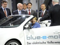 Volkswagen chairman Martin Winterkorn (R) and Chancellor Angela Merkel inspect an electric car during a visit to the Volkswagen plant in Wolfsburg, central Germany, on April 23, 2012. German car maker Volkswagen is expected to ink contracts for a new plant in Xinjiang, northwest China. AFP PHOTO / ODD ANDERSEN …
