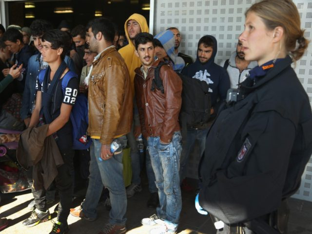 SCHOENEFELD, GERMANY - SEPTEMBER 24: Migrants prepare to board buses that will take them to shelters after they disembarked from a government-chartered train that brought them from Bavaria on September 24, 2015 near Berlin in Schoenefeld, Germany. Germany is continuing to accept throusands of new migrants daily, many of them …