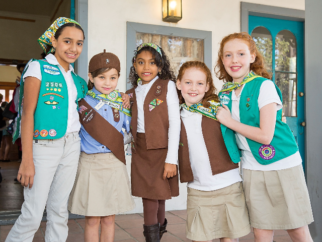 Girl Scouts attend the grand opening of Marisol Deluna New York Design Studio and Educational Foundation at La Villita Historic Art Village on November 18, 2015 in San Antonio, Texas. (Photo by Rick Kern/Getty Images for Marisol Deluna)