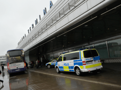 A police bus is parked by the entrance to Arlanda airport, outside Stockholm, on March 22, 2016, after Brussels attacks. / AFP / TT NEWS AGENCY / Johan Nilsson/TT / Sweden OUT (Photo credit should read JOHAN NILSSON/TT/AFP via Getty Images)