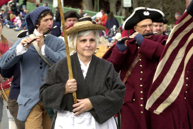 "PLYMOUTH, MA - NOVEMBER 20: Members of a colonial fife and drums corps march in the annual Thanksgiving Parade November 20, 2004 in Plymouth, Massachusetts. The parade, part of a weekend of holiday festivities called ""America's Hometown Celebration,"" commemorates the Plymouth Colony's first Thanksgiving feast of 1621. (Photo by Michael …"