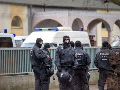 FRANKFURT AM MAIN, GERMANY - FEBRUARY 01: Police stand outside the Bilal mosque in Griesheim district following anti-terror raids across the state of Hesse on February 1, 2017 in Frankfurt, Germany. Approximately 1,000 police officers were involved in the raids of 54 residences, apartments and businesses. Police arrested a Tunisian …