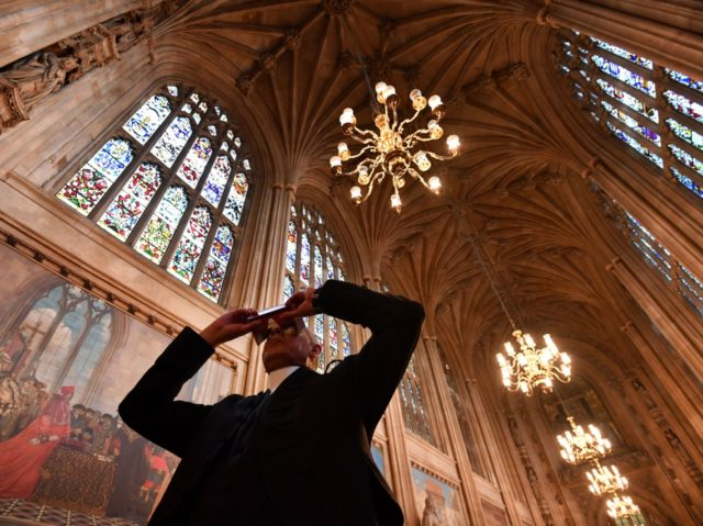 Serjeant-at-Arms of the House of Commons, Kamal El-Hajji, uses a headset to take a 360 degree virtual tour of St Stephen's Hall, as he stands inside the hall at the Houses of Parliament in central London on March 15, 2017, during a photocall to promote the launch of the online …