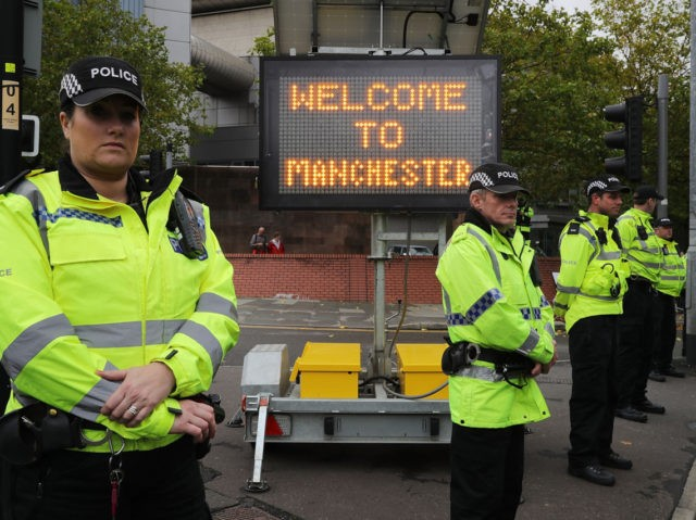 MANCHESTER, ENGLAND - OCTOBER 01: Police stand guard as anti-Brexit and anti-austerity activists take part in protests as the Conservative party annual conference gets underway at Manchester Central on October 1, 2017 in Manchester, England. Five-hundred thousand people are expected to take part in the protests with police mounting an …