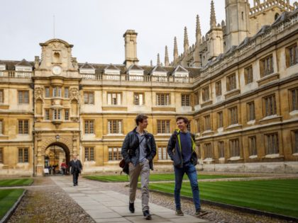 Students walk through Cambridge University in Cambridge, east of England, on March 14, 2018. / AFP PHOTO / Tolga Akmen (Photo credit should read TOLGA AKMEN/AFP via Getty Images)