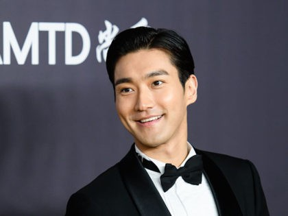 South Korean singer, songwriter, model, and actor Choi Si-won attends the red carpet for the 2018 American Foundation for AIDS Research (amFAR) Hong Kong gala at Shaw Studios in Hong Kong on March 26, 2018. / AFP PHOTO / ANTHONY WALLACE (Photo credit should read ANTHONY WALLACE/AFP via Getty Images)