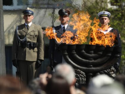 WARSAW, POLAND - APRIL 19: Polish soldiers attend the main commemoration ceremony of the 75th anniversary of the Warsaw Ghetto Uprising on April 19, 2018 in Warsaw, Poland. The Warsaw Ghetto was a prison created by the German military during its occupation of Warsaw during World War II. Starting in …
