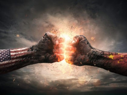 Conflict, close up of two fists hitting each other over dramatic background with copy space