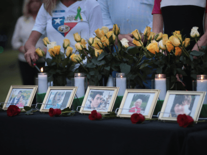 Candles are lit at a prayer vigil to remember the victims from the Santa Fe High School shooting at Walter Hall Park on May 20, 2018 in League City, Texas. Last Friday, 17-year-old student Dimitrios Pagourtzis entered the school with a shotgun and a pistol and opened fire, killing 10 …