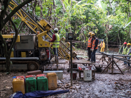 A mineral exploration drilling team drills holes to identify the location and the quality of gold deposits at the Segilola Gold Project site in the village of Iperindo-Odo Ijesha, near the city of Ilesha, Osun State, Nigeria, on May 29, 2018. - Nigeria is working to diversify its economy, which …