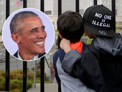 (INSET: Barack Obama) SEATAC, WA - JUNE 09: Javier Tapia (left), age 5, and his brother, Charlie Tapia, age 7, from Seattle, look at a Federal Detention Center holding migrant women on June 9, 2018 in SeaTac, Washington. The boys, whose family is originally from Mexico, were here as part …