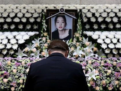 SEOUL, SOUTH KOREA - NOVEMBER 25: A South Korean man pays tribute at a memorial altar as his makes a call of condolence in honor of the K-pop star Goo Hara at the Seoul St. Mary's Hospital on November 25, 2019 in Seoul, South Korea. K-pop star Goo Hara of …