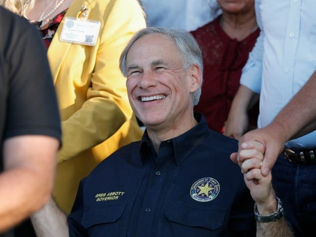 SANTA FE, TX - MAY 18: Texas Governor Greg Abbott holds hands with family and friends at a vigil held at the First Bank in Santa Fe for the victims of a shooting incident at Santa Fe High School where a shooter killed at least 10 students on May 18, …
