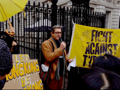 Benedict Rogers founder of the UK based NGO, Hong Kong Watch, outside of the gates of 10 Downing Street. #standwithHongKong protesters marched in London on Saturday, November 23rd, 2019 in solidarity with their friends and relatives back home and to condemn the violence perpetrated by the Hong Kong police and …