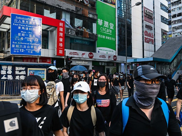 HONG KONG, CHINA - NOVEMBER 2: Protestors march on the street in Causeway bay on November 2, 2019 in Hong Kong, China. Hong Kong slipped into a technical recession on Thursday after anti-government demonstrations stretched into its fifth month while protesters continue to call for Hong Kong's Chief Executive Carrie …